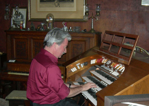 John Fields plays the Rogers organ he donated to the Glendora Historical Society